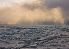 Transparent Baikal ice hummocks at sunset in the fog. Transparent Baikal ice hummocks at sunset in the fog Royalty Free Stock Photo