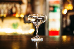 Transparent beverage in glass on bar counter Stock Photo