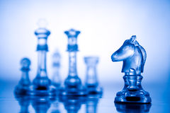 Transparent blue chess Stock Photos