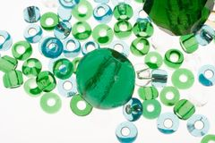 Transparent blue and green glass beads. Macro of transparent blue and green glass beads Stock Photo