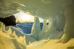 Transparent blue icicle ice cave in Lake Baikal.  royalty free stock photography