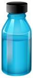 A transparent blue medical bottle Royalty Free Stock Images