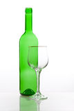 Transparent bottle with glass Stock Image