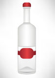 Transparent bottle with red label Stock Photos