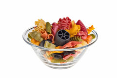 Transparent bowl with italian colourful pasta. Royalty Free Stock Photography