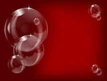 Transparent bubbles  on a red  background Royalty Free Stock Photos