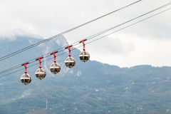 Transparent cable cars that links the Bastille with the city cen Stock Photo