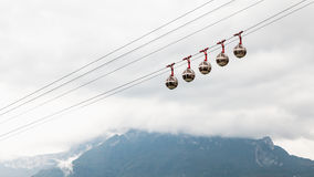 Transparent cable cars that links the Bastille with the city cen Stock Images