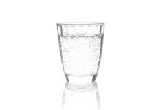 Transparent carbonated drink poured into a transparent container Stock Image