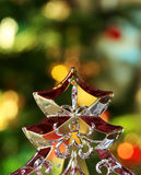 Transparent Christmas Tree. Glass Christmas tree table decoration in front of Christmassy lights royalty free stock photography