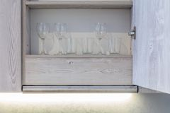 Transparent clean glasses. On shelve in open cabinet Stock Images