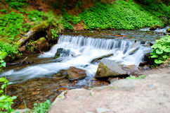 Transparent and clear river. Waterfall. Carpathians. Transparent and clear river. Waterfall Stock Photo