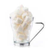 Transparent coffee cup filled with sugar cubes Stock Images