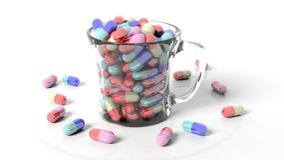 Transparent coffee mug full of pills Stock Image