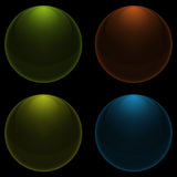 Transparent colored drops on a black background Stock Images