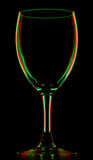 Transparent colored empty wine glass Stock Photos