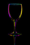 Transparent colored empty wine glass on black Royalty Free Stock Photo