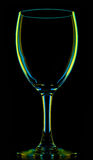 Transparent colored empty wine glass on black Stock Photography