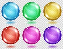 Transparent colored spheres with shadows. Set of translucent colored spheres with shadows on transparent background. Transparency only in vector format Royalty Free Stock Photography