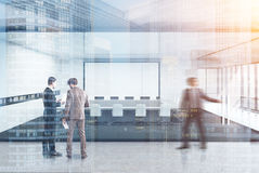 Transparent conference room concrete people. People near a meeting room interior with white and glass walls, concrete floor and a square table with white office Royalty Free Stock Photography