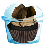 A transparent container with a chocolate cupcake Stock Images