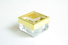 Transparent container with golden cap Stock Image