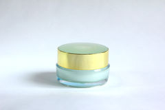 Transparent container with golden cap Stock Photos