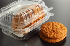 Transparent Container with Oat Cookies. Over black background Royalty Free Stock Photography