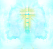 A transparent Cross giving out heavenly light in the sky. Stock Image
