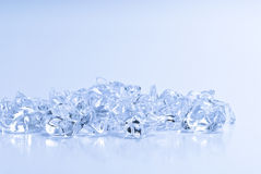 Transparent crystals of ice on a light background Stock Image