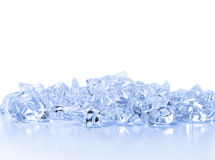 Transparent crystals of ice on a light background Royalty Free Stock Photography
