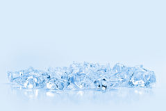Transparent crystals of ice on a light background Stock Images
