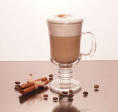 Transparent cup of coffee and cinnamon sticks Stock Photos