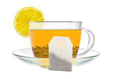 Transparent cup of green tea, lemon and tea bag isolated on whit Royalty Free Stock Image