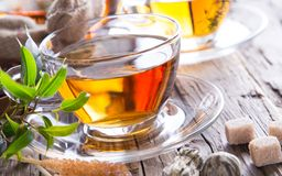 Transparent cup of green tea Royalty Free Stock Photos