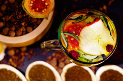 Transparent cup of infusion tea with colorful herbal selection inside, beautiful arrangement, teas and herbs concept Stock Images