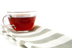 Transparent cup with tea Stock Images