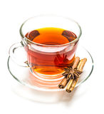Transparent cup of tea and cinnamon steaks on white Royalty Free Stock Images