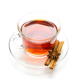 Transparent cup of tea and cinnamon steaks on white Stock Photo