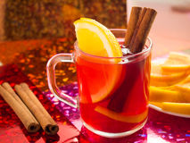 Transparent cup of tea with citrus, cinnamon and orange Royalty Free Stock Images