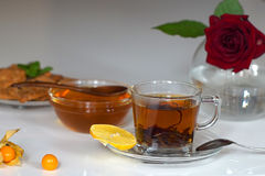Transparent cup of tea with honey Royalty Free Stock Images