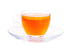 Cup of tea. Transparent cup of tea with lemon on a plate Royalty Free Stock Photos