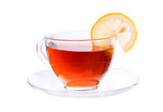 Transparent cup with tea and lemon segment Royalty Free Stock Image