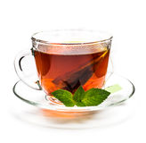 Transparent cup of tea and mint leaves on white Royalty Free Stock Images