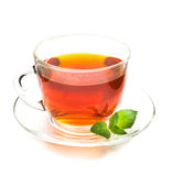 Transparent cup of tea and mint leaves on white Royalty Free Stock Photography