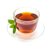 Transparent cup of tea and mint leaves on white Royalty Free Stock Photo