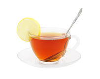 Transparent cup of tea with spoon and lemon. Isolated on white Royalty Free Stock Photos