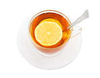 Transparent cup of tea with spoon and lemon. Isolated on white Royalty Free Stock Photography