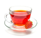 Transparent cup of tea and strawberry on white Stock Image