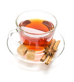 Transparent cup tea, sugar, anise and cinnamon steaks on white Royalty Free Stock Photography